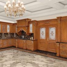 """The Kitchens - Ginevra - Cucina Ginevra laccata finitura legno e patinata in bianco con particolari in foglia oro, ante in legno massello intagliate, cristalli sabbiati e decorati. Marmo """"Emperador Dark."""""""